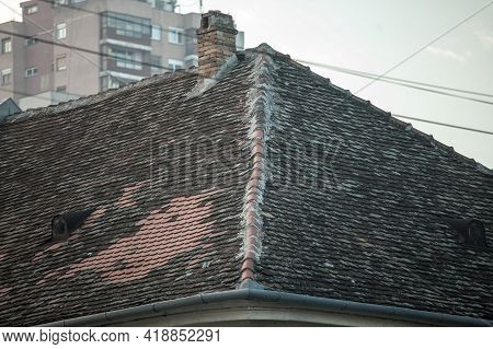 Selective Blur On An Old And Damaged Roof, With Cracked And Missing Tiles. Some Of The Tiles Are Rep