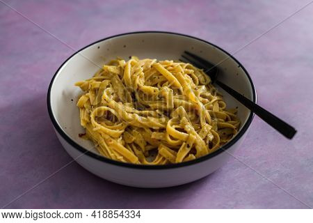 Vegan Lemon And Herbs Sauce Fettuccini Pasta On Pink Background, Healthy Plant-based Food
