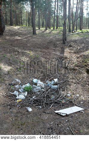 Environmental contamination. Illegal junk dump. .Forest near Kiev, Ukraine