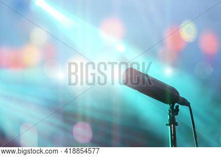 Close Up Modern Microphone For Singers And Colorful Stage Lighting For Concerts. Sound Amplification