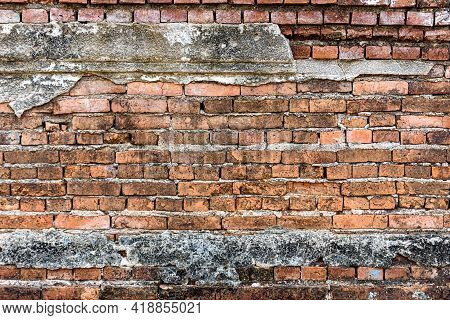Old Shabby Wall Cement Cracks It Is Visible Brickwork. Old Grungy Brickwork Texture.