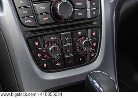 Novosibirsk, Russia - April 25 2021: Opel Astra, Black  Detail With The Air Conditioning Button Insi