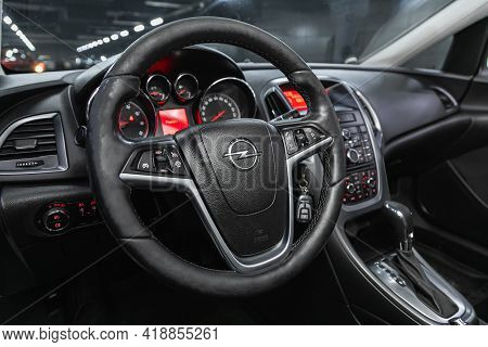 Novosibirsk, Russia - April 25 2021: Opel Astra, Auto Interior: Steering Wheel With Logo And Buttons