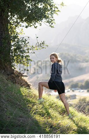 Woman Traveler Hiker With Backpack At Mountain. Girl Hiking A Hill At Panoramic Point. Backpacking T