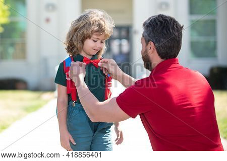 Cute Little Nerd. American Father And Son Walking Trough School Park.