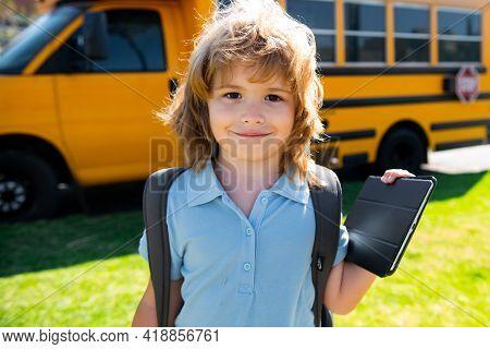 Portrait Of Happy Little Schoolboy Pupil Outdoor On School Bus.
