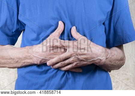 Elderly Man Hands Holding Stomach, Suffering From Stomachache. White Background