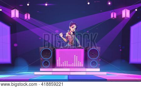 Dj Girl Stand At Turntable In Night Club. Young Woman Disc Jockey In Headphones, Modern Clothes And