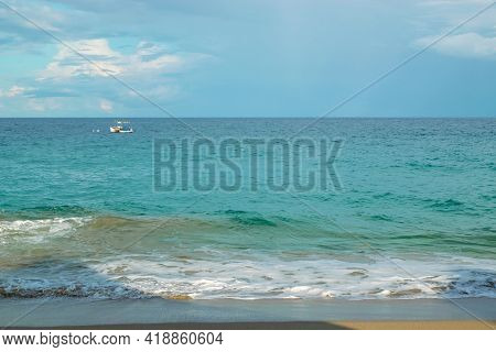 Seascape With Turquoise Water. Catamaran In The Distance. Summer Vacation Concept.