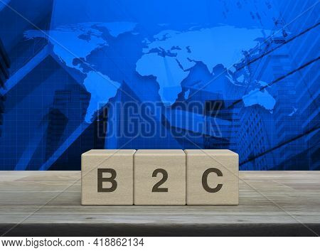 B2c Letter On Block Cubes On Wooden Table Over World Map, Modern Office City Tower And Skyscraper, B