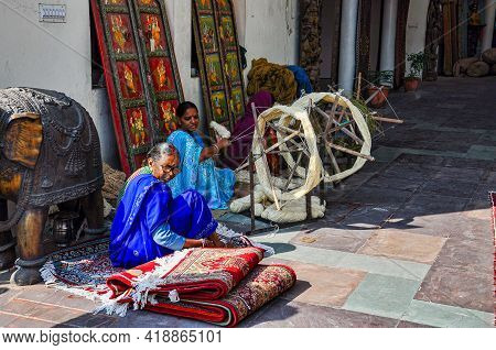 Jaipur, India - Jan 05, 2020: Two Women Weaving And Selling Carpets Near Amber Fort In Jaipur, India