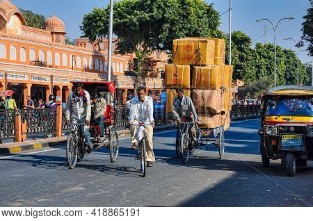 Jaipur, India - Jan 05, 2020: Man Carries Many Boxes On His Bike Near Amber Fort In Jaipur, India.