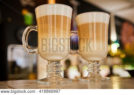 Glasses Of Hot Latte Coffee On The Bar. Close-up, Selective Focus