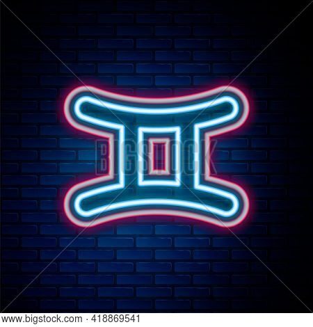 Glowing Neon Line Gemini Zodiac Sign Icon Isolated On Brick Wall Background. Astrological Horoscope