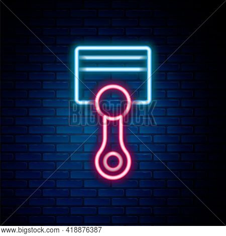 Glowing Neon Line Engine Piston Icon Isolated On Brick Wall Background. Car Engine Piston Sign. Colo