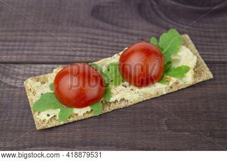 Thin Crunchy Crouton With Arugula And Ripe Cherry Tomatoes, Hummus. Vegan Vegetarian Healthy Tasty S