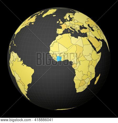 Ivory Coast On Dark Globe With Yellow World Map. Country Highlighted With Blue Color. Satellite Worl