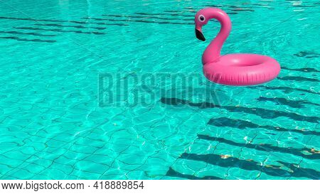 Pink Pool. Pink Inflatable Flamingo In Pool Water For Summer Beach Background. Pool Float Party.