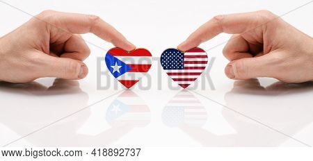 The Concept Of Friendship And Diplomatic Relations Between Puerto Rico And Usa. Two Male Hands Are H