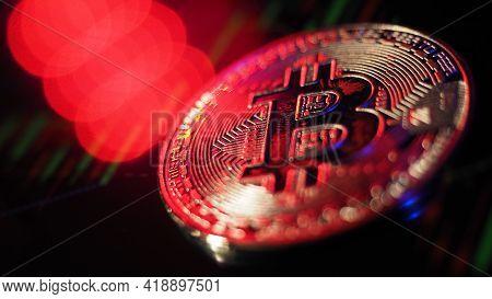 Close Up Bitcoin And Digital Stock Market Graph Bar On Black.