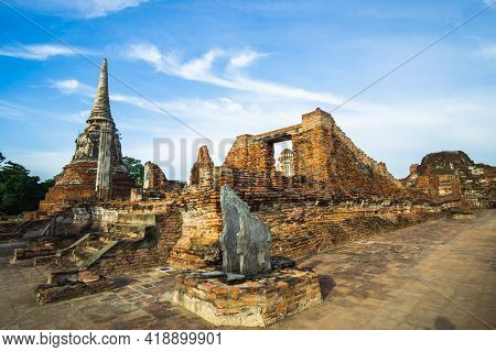 Old Temple With Blue Sky, Wat Phra Mahathat, Royal Temple Of The Ayutthaya.
