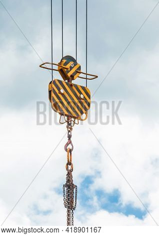 Hoisting Heavy Equipment Lifting Mechanism Of A Tower Crane With A Hook And Chain Against The Sky. C