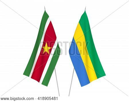 National Fabric Flags Of Gabon And Suriname Isolated On White Background. 3d Rendering Illustration.