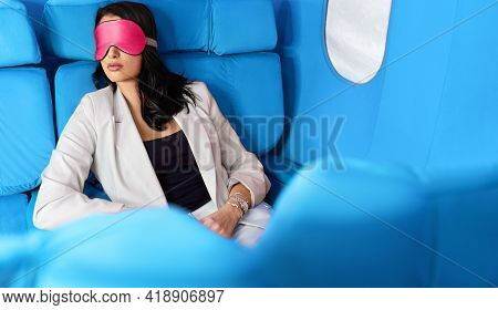 Young Woman In White Suit Sleeping During Flight On The Airplane At The First Class. Female In Sleep