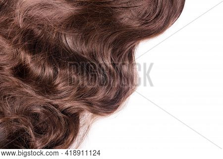 Brown Hair Texture. Wavy Long Curly Light Brown Hair Close Up Isolated On White As Background With C