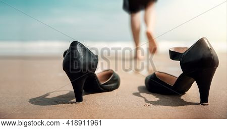 Work Life Balance Concept. Business Woman Take Off Her Working Shoes And Leave It On The Sand Beach