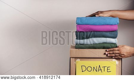 Clothes Donation, Renewable Concept.box Of Use Old Cloth. Preparing Garment At Home Before Donate