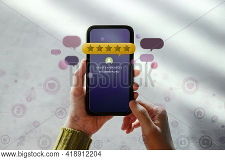 Customer Experiences Concept. Happy Client Using Smartphone To Reading Review Rating For Online Sati