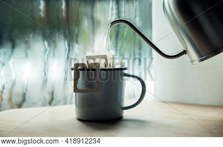 Dripping Coffee By The Window On Morning Rainy Day. Making Hot Drink By Pouring Hot Water From Kettl
