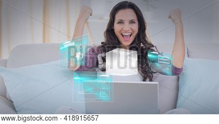 Composition of screens with data processing over businesswoman using laptop. global technology, data processing and digital interface concept digitally generated image.