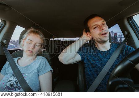 Grane Effect. Tired Yawning Man Driving A Car And Sleeping Woman Together During Road Trip. Passenge