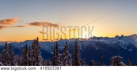 Panoramic View Of Canadian Nature Landscape On Top Of Snow Covered Mountain And Trees During Colorfu