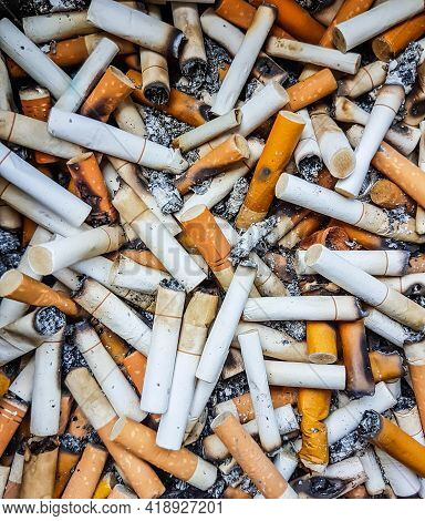 Cigarette Butts Many In The Ashtray. Close Up