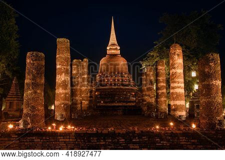 The Scenery Of Wat Sa Si Temple At Night In Sukhothai Province, Thailand.