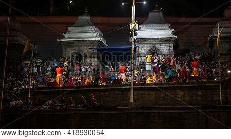 Kathmandu, Nepal - November 2019: Aarati Ceremony At Pashupatinath Temple. Worshipping Evening Praye