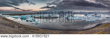 Spectacular Glacier Lake Panorama In Iceland At Dusk