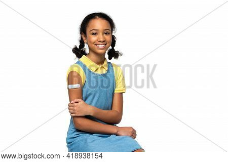 Cheerful African American Kid With Adhesive Patch On Arm Looking At Camera Isolated On White.