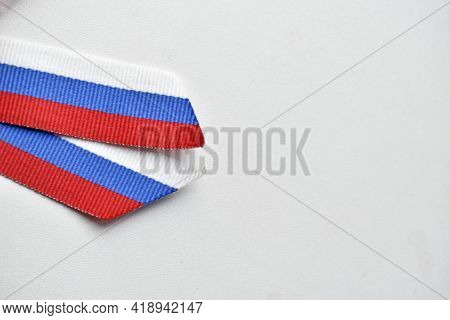 St. George Ribbon And Russian Flag In A Ribbon On Clothes On A White Background