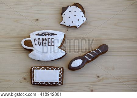 Gingerbreads In The Form Of Cup With Coffee, A Napkin, Spoon, A Coffee Pot. Gingerbreads Are On A Wo