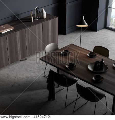 Eating Room Interior With Black Chairs And Wooden Table With Dishes, Top View, Window With Countrysi