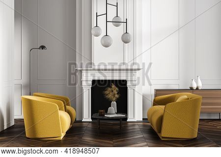 White And Wooden Living Room Interior With Fireplace, Two Yellow Armchairs And Sofa, Coffee Table An