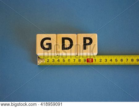 Gdp, Gross Domestic Product Symbol. The Word Gdp, Gross Domestic Product On Cubes Arranged Behind Th