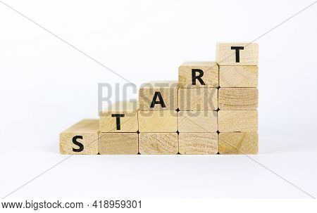 Start Symbol. Concept Word 'start' On Wooden Cubes On A Beautiful White Table. White Background. Bus