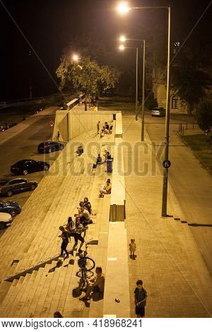 Szeged, Hungary - July 22, 2018: Selective Blur On A Group Of Young People, Boys And Girls, Friends,
