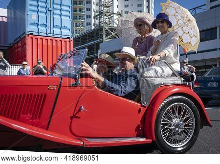 Tauranga New Zealand - April 3 2021; Vintage Car Parade Through City Streets With A Red Mga With Two