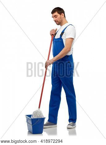 profession, service and people concept - male worker or cleaner in overall cleaning floor with wet mop and bucket over white background